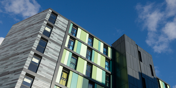 Exterior of Bainfield student accommodation in the sun
