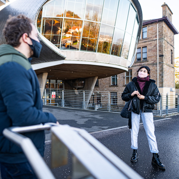Students with masks standing socially distanced outside Craiglockhart campus entrance